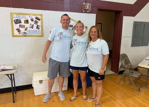 Jim Clarke, a WHS teacher, and girls basketball coach, and a loyal Step Back volunteer, Maddie McCracken (me), and Teresa Cunniff, WHS teacher and head girls basketball coach.