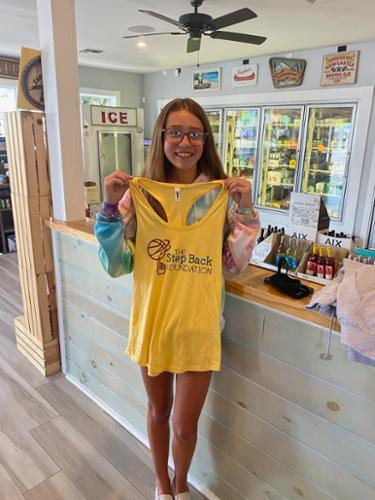 Mia Cripps at Spill the Wine in Wildwood, picking up her Step Back tank!